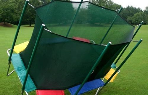 A red, green, yellow, and blue rectangle Magic Circle trampoline tips over.