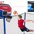 A boy dunks his trampoline basketball with an image of the rim springs hovers above his head