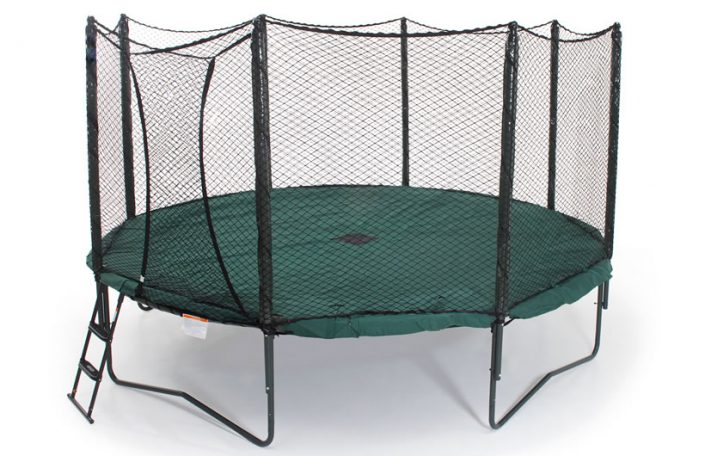 a green trampoline weather cover installed on a 12' trampoline with safety enclosure