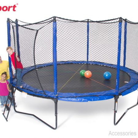 two kids and a man pose next to a JumpSport SoftBounce trampoline