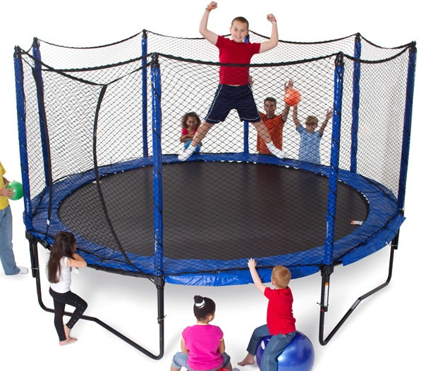a group of kids standing and cheering around a JumpSport PowerBounce 12 foot trampoline