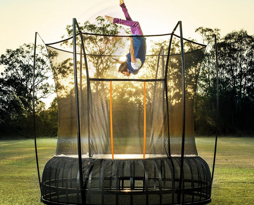 A boy appears to fly upsidedown above a 14 foot extra large Vuly Thunder against a mesmorizing sunset