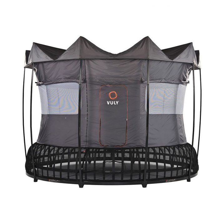 A 14 foot Vuly Thunder trampoline with tent accessory