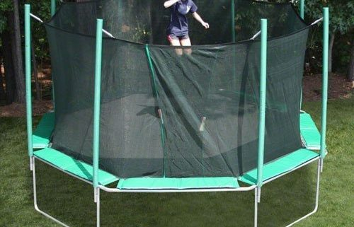 An octagon shaped trampoline with a young girl with ponytails jumping.