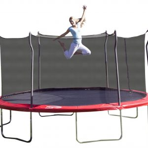 A blond mom in white pants jumps on a red Propel trampoline