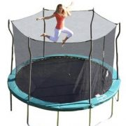 Blond mom jumps and flairs arms on trampoline