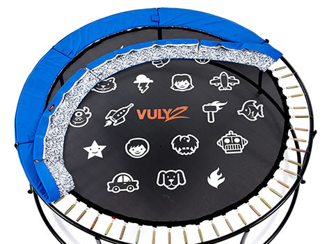 A HexVex trampoline mat with blue pad lifted to reveal springs